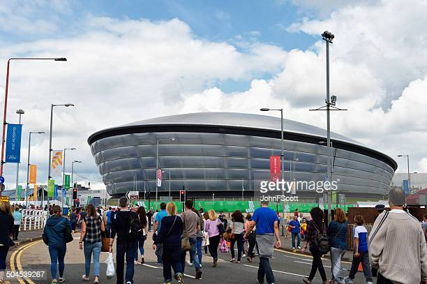 crowds walking towards the hydro during glasgows commonwealth games 2014 - sports event stock photos and pictures