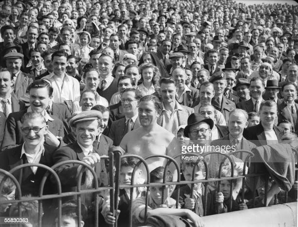 Crowds watch a Chelsea versus Derby County football match at Stamford Bridge during an Easter heatwave in London 16th April 1949