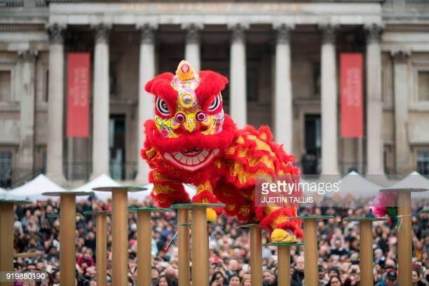 Crowds watch a Flying Lion Dance performance in Trafalgar Square as people celebrate the Chinese Lunar New Year in central London on February 18 2018...