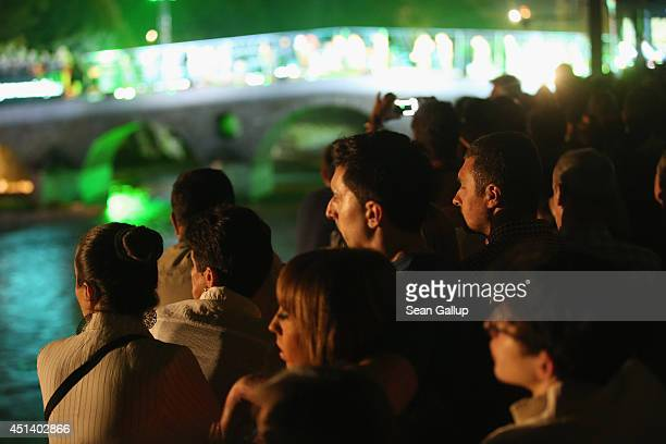 Crowds watch actors perform on the Latin Bridge during a theatrical piece commemorating World War I near the spot where Serbian secessionist Gavrilo...