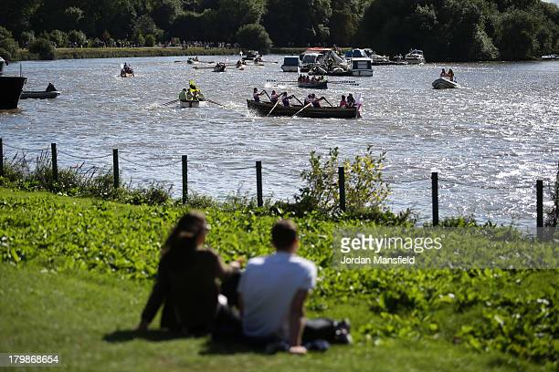 Crowds watch as crews compete in the annual 'Great River Race' a 22 mile rowing race on the River Thames from the Docklands to Richmond on September...