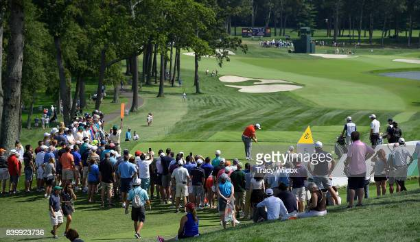 Crowds watch as Jon Rahm hits his tee shot at the fifth hole during the final round of THE NORTHERN TRUST at Glen Oaks Club on August 27 in Old...