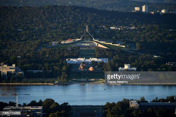 Crowds watch as Skywhalepapa is inflated in front of the Australian Parliament House next to the original Skywhale on February 07, 2021 in Canberra,...