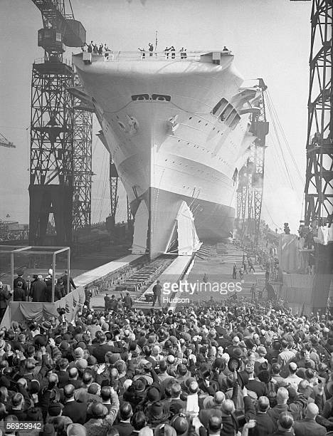 Crowds watch as the 22000 ton aircraft carrier HMS Ark Royal is launched at the Cammell Laird shipyard in Birkenhead 13th April 1937 The ship was...