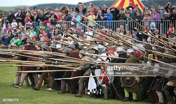 Crowds watch as the Battle of Bannockburn is reenacted on June 28 2014 in Stirling Scotland The 700th anniversary of the historic battle that saw the...