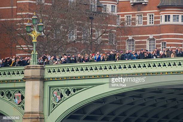 Crowds watch from Westminster Bridge as the Havengore makes its way along the River Thames during a recreation of the journey it made 50 years ago...