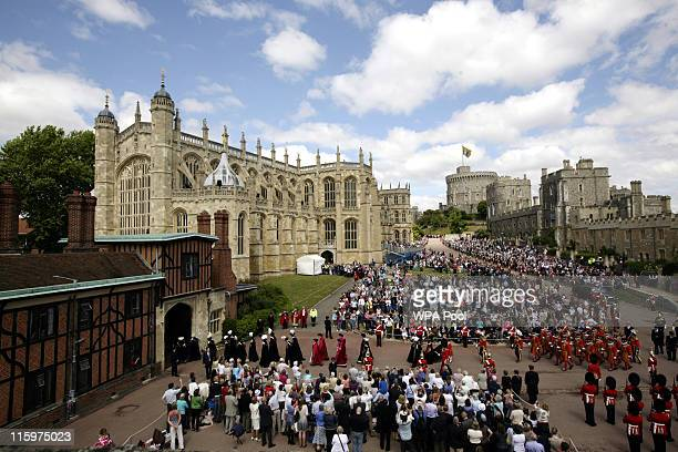Crowds watch members of the Order of the Garter arrive for the annual Order of the Garter Service at St George's Chapel, Windsor Castle on June 13,...
