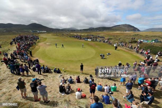 Crowds watch Northern Ireland's Rory McIlroy and England's Aaron Rai on the 11th green during day four of the Dubai Duty Free Irish Open at...