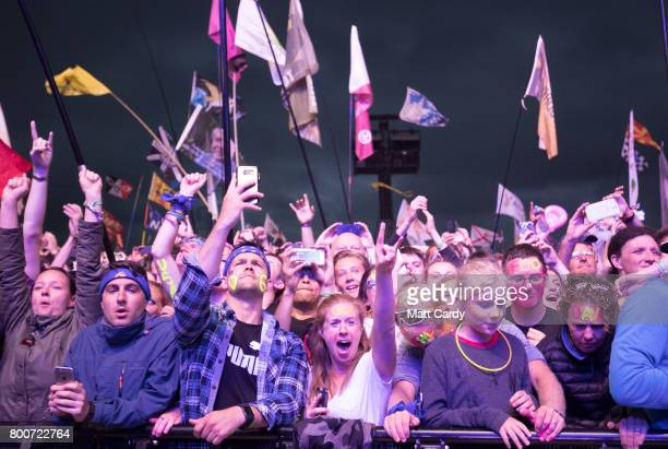 Crowds watch the Foo Fighters performance at the Glastonbury Festival site at Worthy Farm in Pilton on June 24 2017 near Glastonbury England...