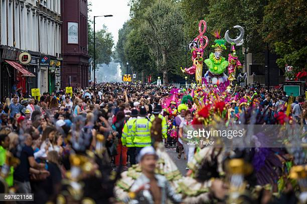 Crowds watch the parade at the Notting Hill Carnival on August 29 2016 in London England The Notting Hill Carnival which has taken place annually...