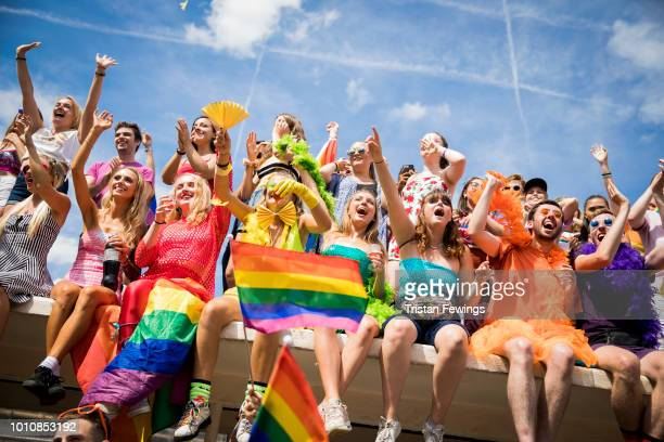 Crowds watch the parade during Brighton Pride 2018 on August 4 2018 in Brighton England