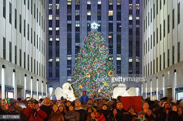 Crowds watch the Saks Fifth Avenue Christmas light show from Rockefeller Center, New York City.