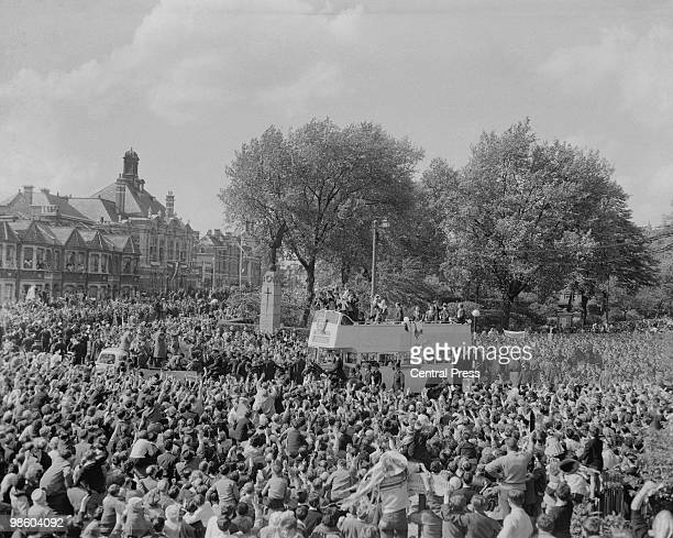 Crowds watch the Tottenham Hotspur football team as they are driven to Tottenham Town Hall in an open top bus for a mayoral reception in honour of...