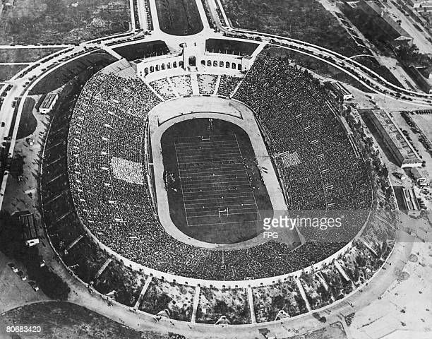 Crowds watching an American football match at the Los Angeles Memorial Coliseum circa 1930