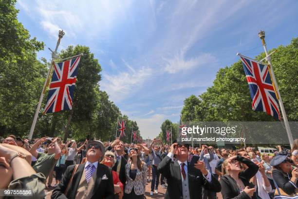 Crowds watching fly past on The Mall, London