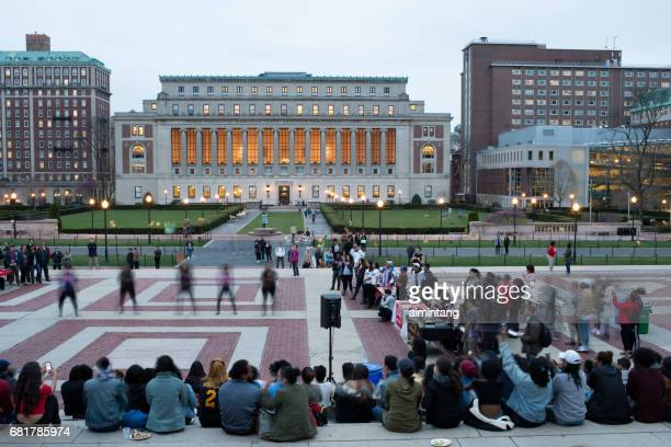 crowds watching students dancing in campus of columbia university - columbia university stock pictures, royalty-free photos & images