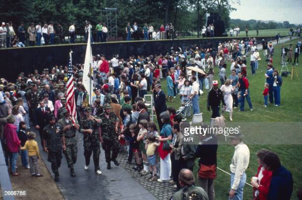 Crowds watching the dedication ceremony at the Vietnam Memorial in Washington DC