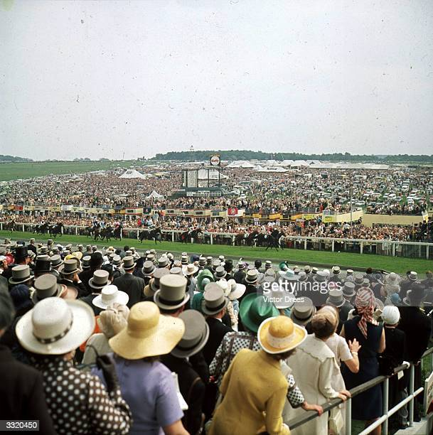 Crowds watching the finish of the second race on Derby Day at Epsom.