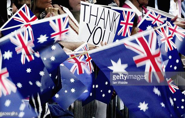 Crowds wave flags and banners during the Anzac Day parade April 25 2005 in Sydney Australia Australians and New Zealanders today commemorate the 90th...