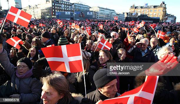 Crowds waving Danish flags gather during the official reception to celebrate Queen Margarethe II of Denmark's 40 years on the throne at City Hall on...