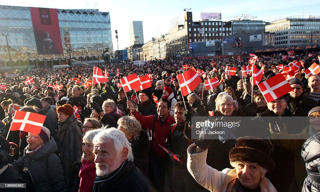 Crowds waving Danish flags gather during the official reception to celebrate Queen Margarethe II of Denmark's 40 years on the throne at City Hall on January 14, 2012 in Copenhagen, Denmark.