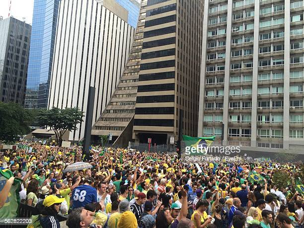 Crowds With Brazilian Flag On Street In City