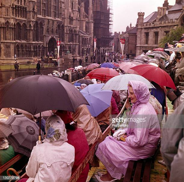Crowds with umbrellas waiting in the rain across from York Minster for the wedding procession of the Duke of Kent and his bride-to-be, Katharine...