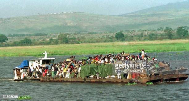 Crowdy ferry leaves Kinshassa 09 May 2000, to Bandudu province some 500 kilometres from the capital city.