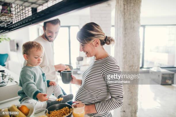 crowdy in our kitchen - pregnant stock pictures, royalty-free photos & images
