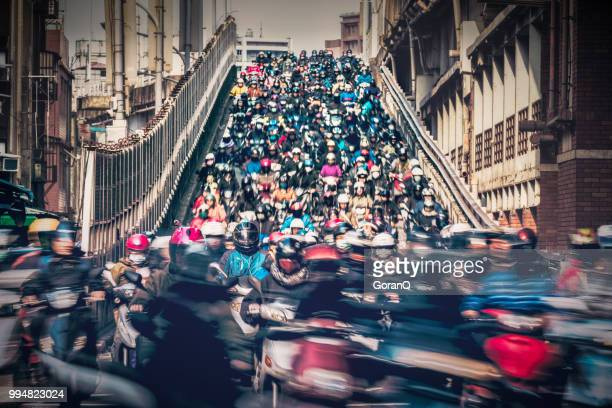 crowed of people are riding scooters - taipei stock pictures, royalty-free photos & images