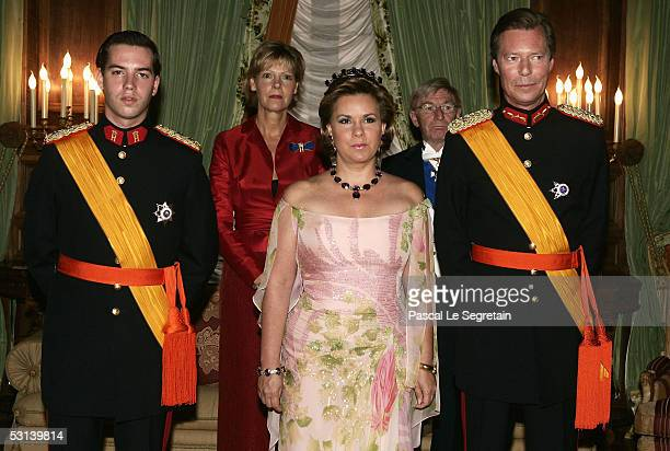 Crown Grand Duke Guillaume of Luxembourg, Grand Duchess Maria Theresa and Grand Duke Henri of Luxembourg attend a dinner at the Grand Ducal Palace as...