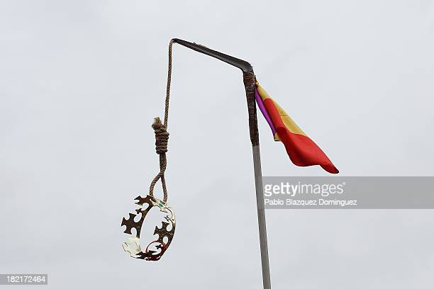 A crown hangs from a gallows adorned with the Republican flag during a demonstration against the Spanish Monarchy under the header 'Check the King'...