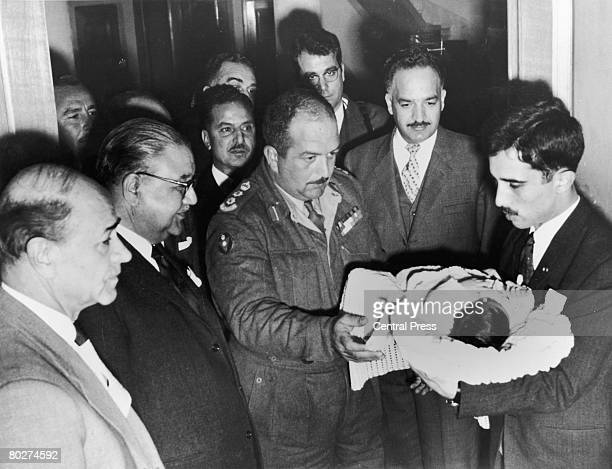 Crown Prince Abdullah son of King Hussein and Princess Muna alHussein of Jordan is shown to various government officials at the royal palace in Amman...