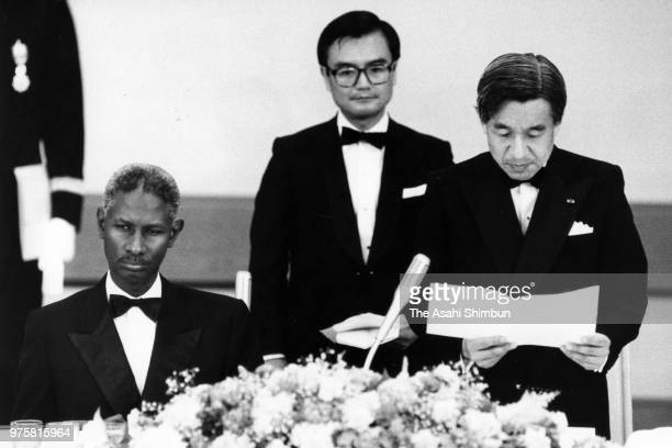 Crown Prince Akihito addresses while Senegalese President Abdou Diouf listens during the state dinner at the Imperial Palace on June 29 1988 in Tokyo...