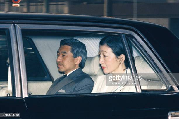 Crown Prince Akihito and Crown Princess Michiko are seen on arrival at the Imperial Palace to see Emperor Hirohito on December 5 1988 in Tokyo Japan