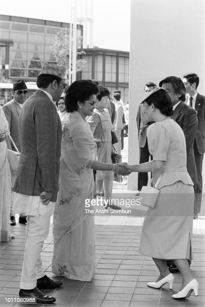 Crown Prince Akihito and Crown Princess Michiko are welcomed by King Birendra and Queen Aishwarya of Nepal at the Nepal Pavillion at the Expo '85 on...