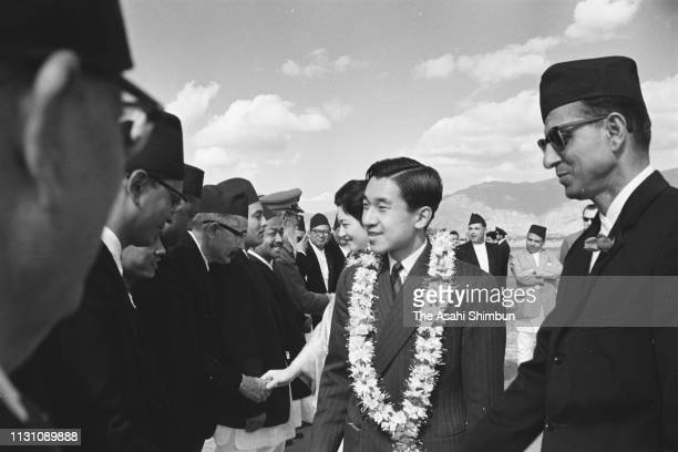 Crown Prince Akihito and Crown Princess Michiko are welcomed by King Mahendra and Queen Ratna of Nepal on arrival at Gauchaur Airport on December 6...