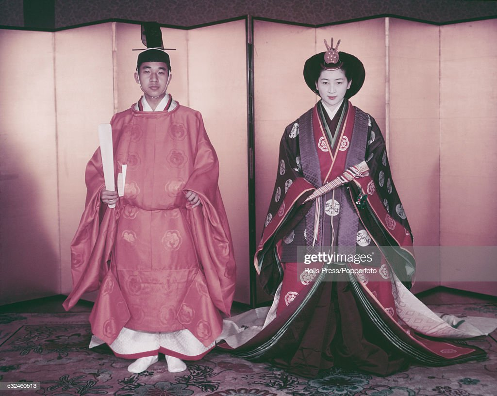 Crown Prince Akihito and Crown Princess Michiko of Japan pictured together wearing their traditional wedding attire of a sokutai for him and a junihitoe for her on their wedding day in Tokyo, Japan on 10th April 1959.