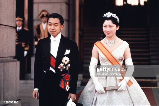 Crown Prince Akihito and Crown Princess Michiko pose for photographs at the Imperial Palace after the ChokennoGi first greeting with Emperor Hirohito...