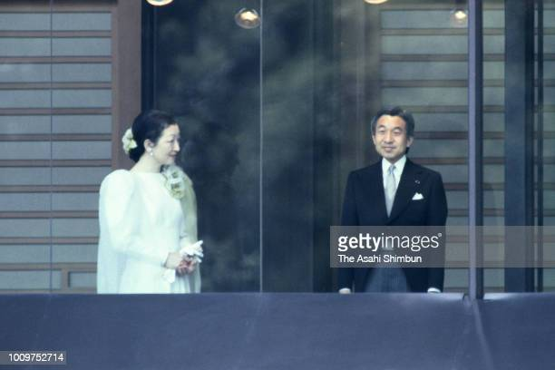 Crown Prince Akihito and Crown Princess Michiko stand at a balcony as Emperor Hirohito turns 84 at the Imperial Palace on April 29 1985 in Tokyo Japan