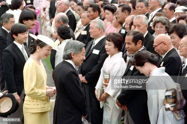 Crown Prince Akihito and Crown Princess Michiko talk to former baseball player Sachio Kinugasa during the spring garden party at the Akasaka Imperial...