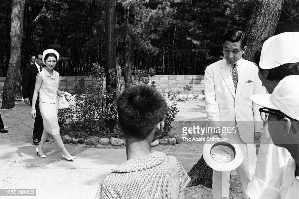 Crown Prince Akihito and Crown Princess Michiko visit the Tottori Prefecture Seishi Gakuen, facility for physically handicapped, on August 10, 1966...