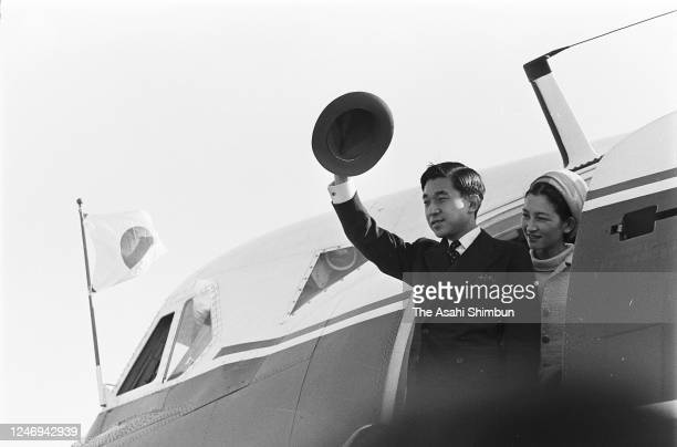 Crown Prince Akihito and Crown Princess Michiko wave to well-wishers on departure for Tokyo at the Yonago Airport on October 10, 1967 in Yonago,...