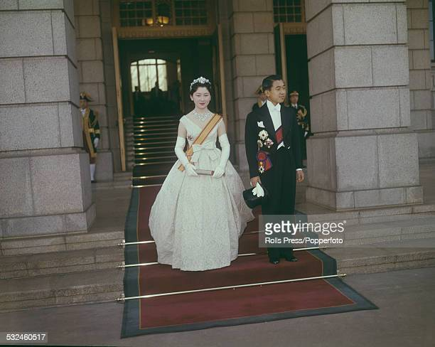 Crown Prince Akihito and his bride Michiko Shoda leave the Imperial Palace after their wedding ceremony in Tokyo, Japan on 10th April 1959.