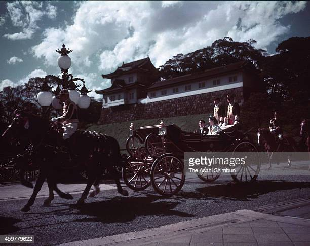 Crown Prince Akihito and Michiko Shoda are seen departing for their wedding parade on April 10 1959 in Tokyo Japan