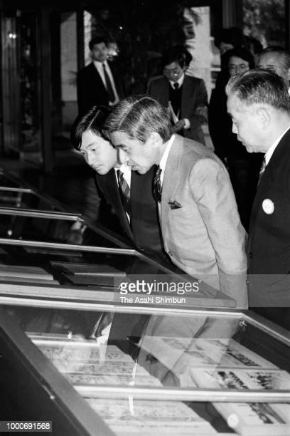 Crown Prince Akihito and Prince Naruhito visit the National Archives of Japan on November 12 1986 in Tokyo Japan