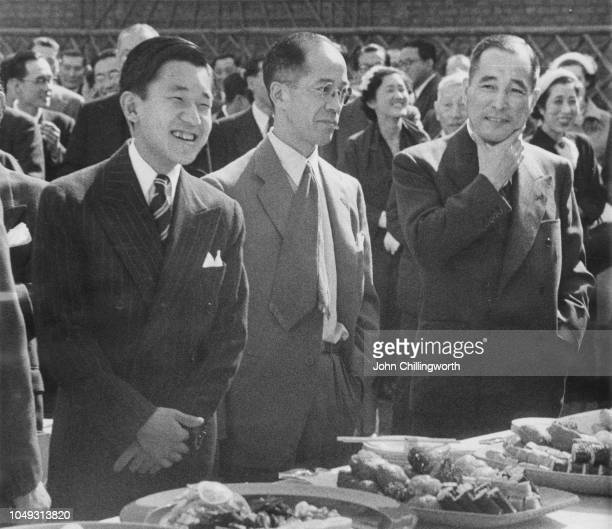 Crown Prince Akihito of Japan at a garden party given for Japanese residents in London, May 1953. On the right is Koichiro Asakai , the Japanese...