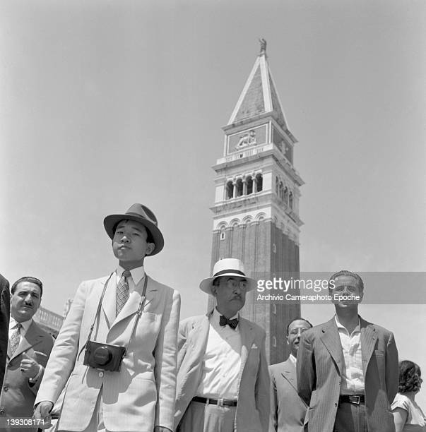 Crown Prince Akihito of Japan in St. Mark's Square, Venice, 1953. The Campanile of St Mark's church is in the background.