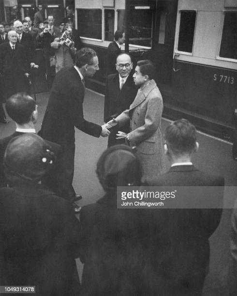 Crown Prince Akihito of Japan is greeted by royal Lord in Waiting George DouglasHamilton 10th Earl of Selkirk on his arrival at Waterloo Station...