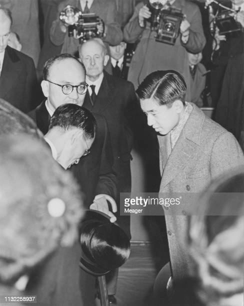Crown Prince Akihito of Japan , later Emperor Akihito of Japan, is officially welcomed on his arrival in London to attend the Coronation of Queen...